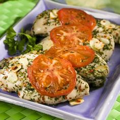 Chicken with Garlic, Basil, and Parsley   1 tablespoon dried parsley, divided  1 tablespoon dried basil, divided  4 skinless, boneless chicken breast halves  4 cloves garlic, thinly sliced  1/2 teaspoon salt  1/2 teaspoon crushed red pepper flakes  2 tomatoes, sliced