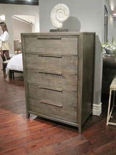 LOVING the finish on this dresser. Could it be recreated with wallpaper or something I wonder?