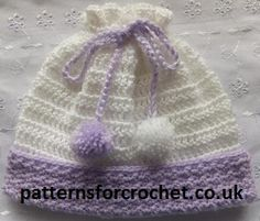 Baby Crochet Pattern Pull on hat with pom-poms, can be matched with Ribbed Cardigan to make a set. FREE.  http://www.patternsforcrochet.co.uk/pull-on-hat-usa.html