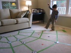 Halloween game: Spider Web Walking. Stay on the web/tape and collect the plastic spiders.