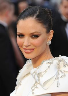 Georgina Chapman attended the 84th Annual Academy Awards wearing a pair of pear and marquise-cut diamond cluster earrings. Brand: Chopard
