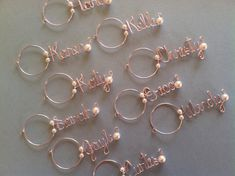 These darling personalized name wine charms are the perfect hostess, bridesmaid, or shower gift or Xmas gift. They also make excellent birthday/friendship gifts. Everybody loves to see their name written in wire. Please convo me for RUSH ORDERS, I can almost always accommodate at no extra charge!    Please convo me with the color of bead you want on your charm, default bead will be a pearl.     This listing is for one wine glass charm, however you can order as many as you want. I offer a .25…
