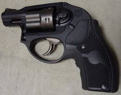 Ruger LCR .38 Special. Hammer-less, perfect for carry in a concealed carry purse. Great trigger pull and no worries of jams. Great gun for people who have hand strength issues, arthritis or just like the simplicity of a revolver!