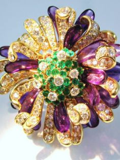 Unbelievable Bulgari flower brooch made from emeralds, diamonds and petals carved from amethyst- a rare, wearable work of art