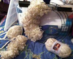 wreath with sashay yarn Ruffle Yarn Projects, Sashay Yarn Projects, Ribbon Projects, Crochet Projects, Crochet Pouf, Crochet Wreath, Crochet Gloves, Crochet Gifts, Crochet Ruffle
