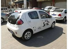 A car I spotted in Beijing, covered in Tarepanda, the laziest panda ever. Americans are falling behind in the car-decorating game. Here's an explanation of Tarepanda http://en.wikipedia.org/wiki/Tarepanda