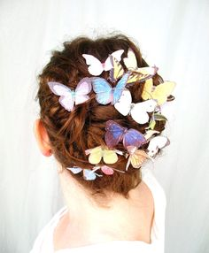 three handmade silk butterfly hair clips . 'the butterfly house' . your choice . whimsical and enchanting. $16.00, via Etsy.
