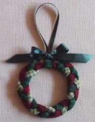 Braided Wreath Ornament | Here's an easy idea to use up leftover strips of fabric: make a braided Christmas wreath ornament! For best results, use three different fabrics.