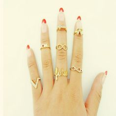 A Suit of Stylish Chic Bowknot V Letter Rings