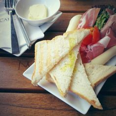 Prusciutto, cheese, fresh vegetables and toasts with butter @ Cafe Dias