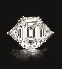 Set with a modified rectangular-cut diamond, weighing approximately 22.46 carats, flanked on either side by a trillion-cut diamond, mounted in platinum. Signed Webb for David Webb