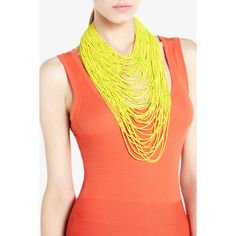 Love the layered look in one necklace. Wondering how hot it may make one feel with all these beads around your neck on a summer day