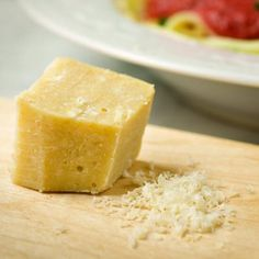 Dairy-free Parmesan Cheese- I never thought I'd invent Vegan Parmesan Cheese. Well, here it is! Ladies and gentlemen you can grate it, slice it, or cut into chunks. It is dairy-free and fabulicious! Click the image for the recipe. Vegan Cheese Recipes, Vegan Parmesan Cheese, Vegan Foods, Vegan Dishes, Dairy Free Recipes, Paleo Vegan, Paleo Pizza, Vegan Raw, Cheddar Cheese