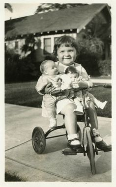 """Vintage Photo """"Traveling with Friends"""", i used to do this.  I had an old draw string purse of my mom's which I put clothes in and my doll to hang on the handlebars of my trike.  d--"""