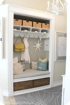 Maybe we'll remove the closet door by the entry and turn the closet into something like this. It would provide a place to sit to put shoes on & off.