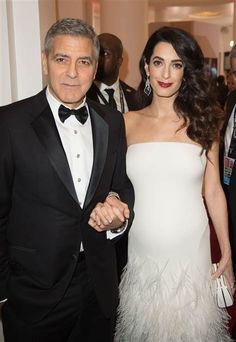 George & Amal Clooney at the Feb 2017 Cesar Awards in France.  Both beaming with the June upcoming births of their twins ... boy and girl.