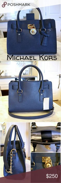 Michael Kors Hamilton EW Satchel This chic Michael Kors purse features a gold chain and leather strap. Gold lock and key fixture on front. 2 slip pockets, 1 zipper pocket and a key clip. Material: Saffiano Leather Color: Navy MICHAEL Michael Kors Bags Satchels