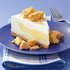 Lemon Surprise Cheesecake Recipe -Lemon flavors sparkle throughout this cheesecake, from the crust to the filling to the topping. Build up the edges of the cheesecake to keep the lemon filling right where you want it. —Karen Chesnut, Clarksburg, California