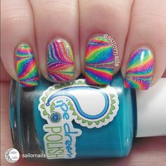 repost via @instarepost20 from @sailornails Another @pipedreampolish A Night in Vegas cremes watermarble! I can't bring myself to watermarble with anything else. These are too amazing! This time I went a bit more glitzy. The base of my ring finger is @danglefootnailpolish Cosmic Girl and the glitter topper is @chinaglazeofficial Fairy Dust. The clear polish for my ring finger is @opinailsuk Nail Envy which watermarbles perfectly! I've filmed tutorials for both of these and they will be up…