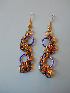 164.  Spiraled Seahorse Pattern with gold and Purple. $25