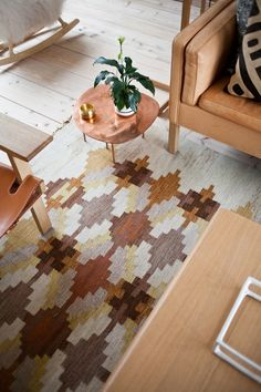 love the rug and little brass table at mjölk house.