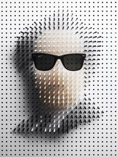 Karlberg's six famous sunglass wearers were created using 1,200 sticks and photographed over six days.
