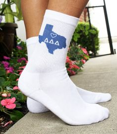 Sorority State Socks - Select Your State and Sorority  Sold by the pair - Delta Delta Delta / Texas shown. All 50 states available. Sockprints is a licensed vendor for all 26 NPC sororities. Our socks are printed with environment friendly apparel inks and will not fade with washing (no bleach please!). The design is printed on the outside of each sock in a sorority color.    Select the sorority & state you would like printed on the socks and include it in the notes section at checkout.