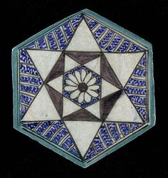 Tile | Origin: Syria or Egypt | Period:  15th century | Collection: The Madina Collection of Islamic Art, gift of Camilla Chandler Frost (M.2002.1.764) | Type: Ceramic; Architectural element, Fritware, underglaze-painted, Diameter: 7 15/16 in. (20.16 cm); Depth: 1/2 in. (1.27 cm)