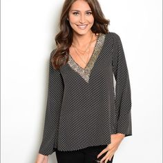 Polka Dot Blouse Adorable polka dot blouse with gold detailing in the V neck area Tops Blouses