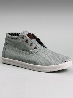 Toms® shoes Men's Canvas Botas in Grey Chambray.  Waxed canvas makes for the softest TOMS shoes Botas mens canvas shoe yet. A stylish lace-up ankle boot designed with a padded collar, soft felt lining and a cushioned leather footbed is great whether you're out hiking the hills or walking at the mall. With or without laces - great to have that choice!