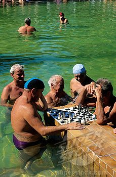 Anyone for chess? Old masters play in the steaming waters of the Széchenyi Thermal baths, Budapest, Hungary