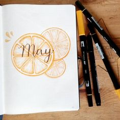Bullet journal monthly cover page, May cover page, hand lettering, orange slices drawing. | @crafter.pillar