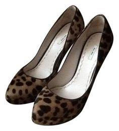 """Authentic Miu Miu for PRADA Leopard Pony Hair Pumps Shoes                                                                                                                               Size EU 37.5/ US 7.5   Color: Leopard Pony Hair  EXCELLENT CONDITION.  Heels are LIKE NEW  SEXY 5"""" heel with a 1"""" platform                                                                                  MADE IN ITALY  *FREE SHIPPING!*  Amazing CHRISTMAS GIFT!!  WILL SHIP RIGHT AWAY! Check out my other items!"""