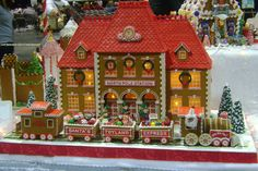 Gingerbread House Designs with a train in front Gingerbread Castle, Cool Gingerbread Houses, Gingerbread House Designs, Gingerbread Decorations, Christmas Gingerbread House, Gingerbread Cookies, Christmas Cookies, Christmas Holidays, Xmas