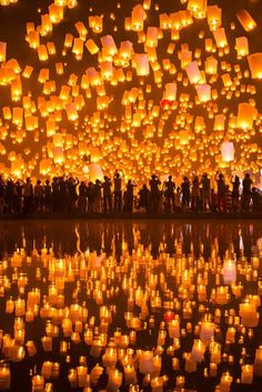 Yellow is the color associated with the Earth element. Lanterns.  Chiang Mai Yii Peng Festival, Thailand