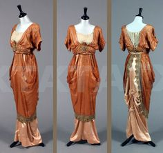 Evening gown, Mme. Ernest Ltd., ca. 1910. Cinnamon gauze silk and satin evening gown with elaborate woven label to bodice waist, the separate bodice with lace chemisette, elaborately embroidered waistband, and metal thread-wrapped buttons, beads and rosettes. The internal tulle camisole has elasticated silk straps, the pink satin hobble skirt has a deep, boned inner waistband, the draped gauze veiling forming drapes at the side. Kerry Taylor Auctions.
