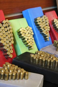 {bullet or shotgun shell art} great idea for a man cave! shapes: initial, stag, bullseye, arrow, tree or branch, etc    This would be cute to do in the kids room (with all the shells the kids have shot)