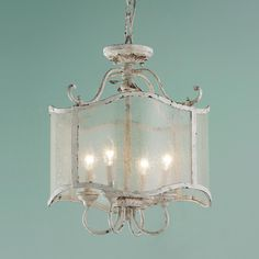 """Graceful lines in distressed cream iron are complemented with heavily seeded glass and acanthus leaf detailing for vintage French flair. 4x60 watt candelabra with faux drip covers in cream. (19""""Hx15""""W)"""