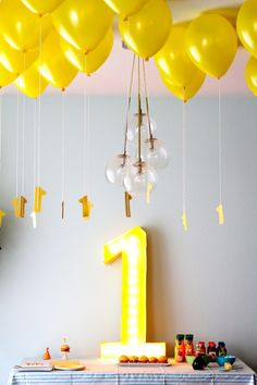 A really simple & low key 1st birthday party. I love the marquee style 1 sign and the addition of the 1's on the balloon strings. Just think at the delight on your toddler's face as they reach up to grab the 1's all party long - great photo opportunities! :-)