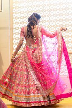 A pink gota patti lehenga by Anita Dongre for Bride Khyati #weddingsutra #bridallehenga #lehenga #Indianbride #Indianoutfit #bridallook #weddingideas #ideas #desibride #bride #bridaloutfit #designer #anitadongre #pink Photo Courtesy- Dev Purbiya