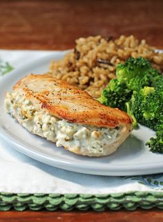 Cream Cheese and Herb Stuffed Chicken - Emily Bites , This Cream Cheese and Herb Stuffed Chicken is an easy, low carb dinner you'll love! Just 307 calories or 7 Green, 4 Blue or 4 Purple myWW SmartPoints . Low Carb Dinner Recipes, Ww Recipes, Cooking Recipes, Healthy Recipes, Cream Cheese Chicken, Weight Watchers Meals, Stuffed Peppers, Dishes, Stuffed Chicken Recipes