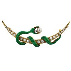 Victorian  Finely detailed Green Enamel Snake twisted around a seed pearl encrusted 15 Karat yellow gold Crescent Moon.