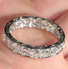 This is a Vintage French Retro 3.8 ctw Diamond Eternity Ring in Platinum from 1940.