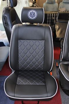 A popular style, but in a new colour! This beautiful set of seats are in the smooth black vinyl that we have used previously but they have white single stitching, piping and VW logo's.