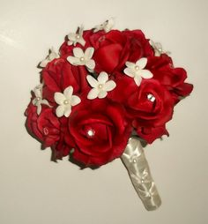 Hey, I found this really awesome Etsy listing at http://www.etsy.com/listing/105214470/real-touch-red-rose-bouquet-with