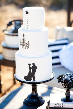 black and white wedding cake with silhouettes // photo by AK Studio Design // cake by Sweet Cakes by Karen