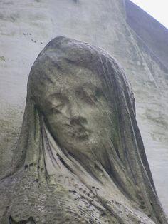 Warsaw. Powązki. Tomb sculpture - woman with a veiled face. by Łukasz Rokicki,