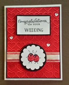A wedding card featuring Stampin' Up! Host set Love You Lots, the happy hearts TIEF, Wild about Flowers and tin of cards stamp sets for the greetings. It would make a cute valentines card with a different sentiment.