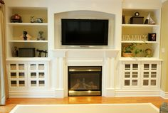 fireplace + built ins - I like the doors on the cabinets