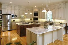 Kitchen, Bath and Closet Cabinetry by Wellborn Cabinet, Inc. Think  this kitchen could handle a lot of baking!